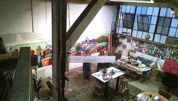 Jett Jackson and her mural in progress for DTLA's Urban Radish