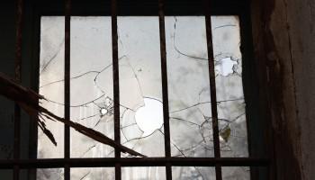 Broken window. Photo by Tomas Castelazo, courtesy Wikicommons