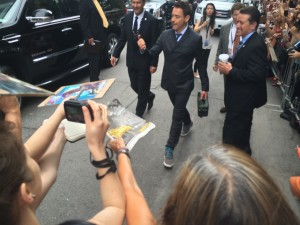 Robert Downey Jr., emerges to greet fans and press.