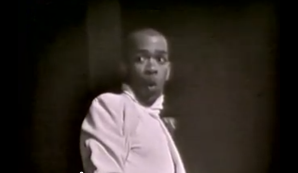 "A young Geoffrey Holder in a scene from ""Carmen and Geoffrey"