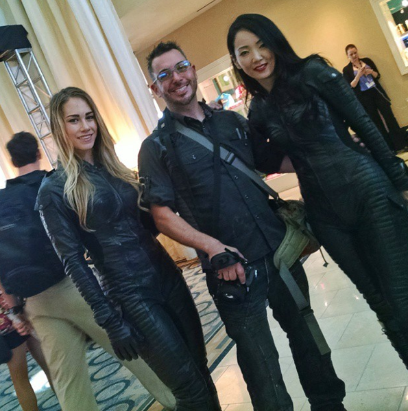 Will you finance our movie? A writer-director-producer with two of his stars. This one was about hot biker chicks who chase vampires. Or are vampires. Or something like that.