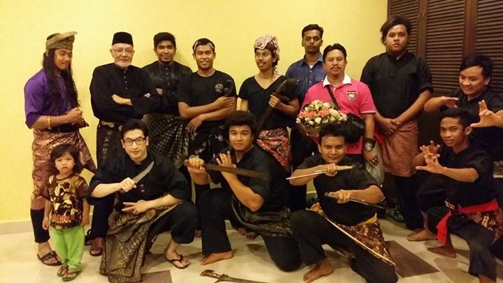 The silat group clad in traditional silat costumes after a performance.