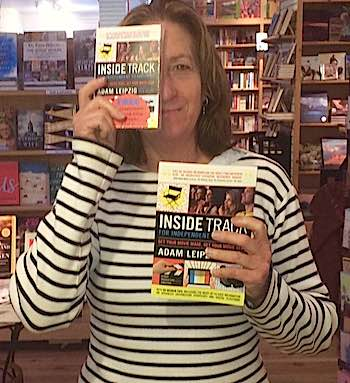 Sue Fassett, manager of Dolly's Bookstore in Park City, with 'Inside Track'