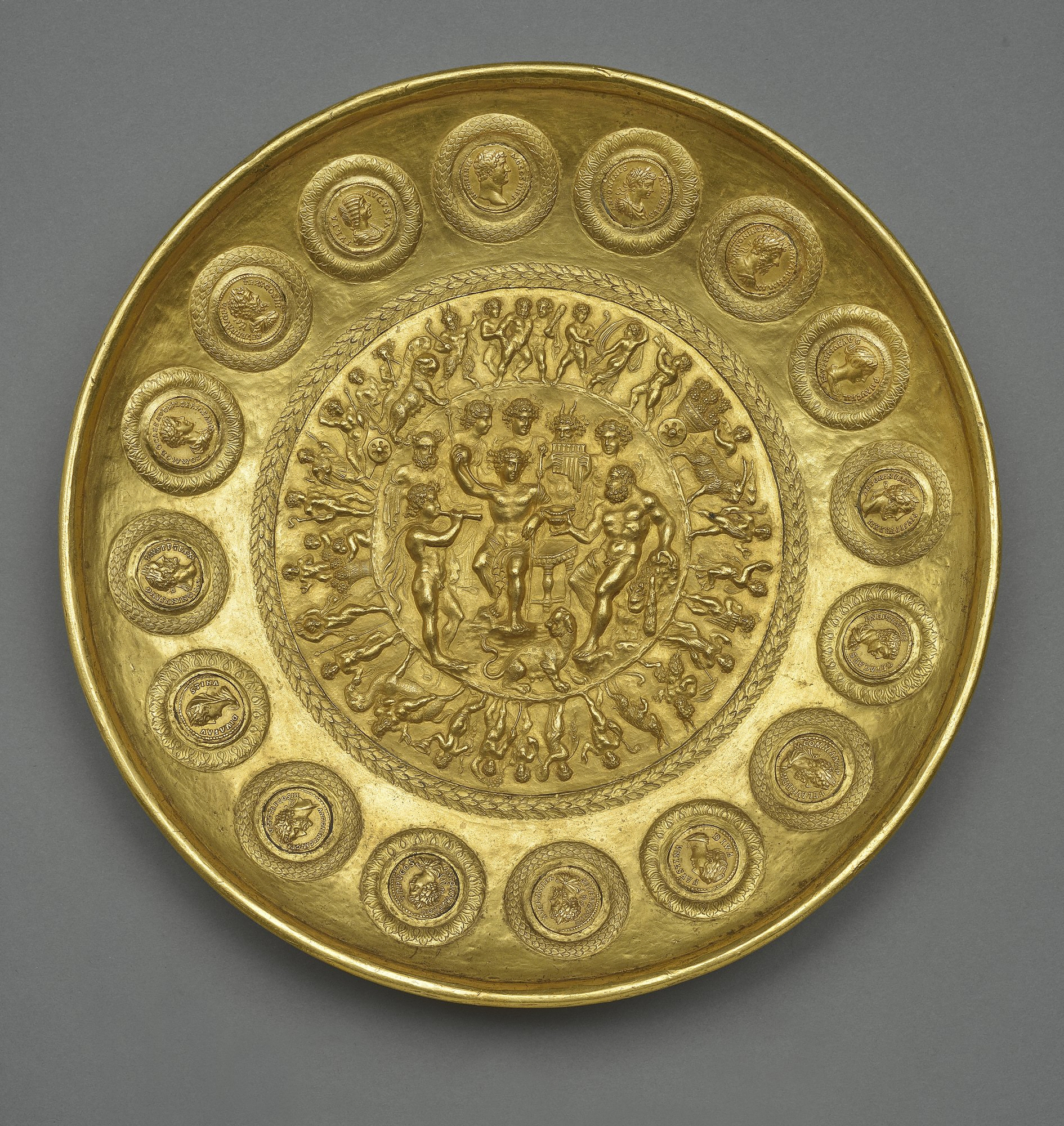 "5. Offering bowl with Bacchus, Hercules and Coins, "" Rennes patera,"" Roman. about 210 A.D. Gold. Cabinet de Médailes of the Bibliothèque nationale de France, Département des monnaies et antiques, Paris."