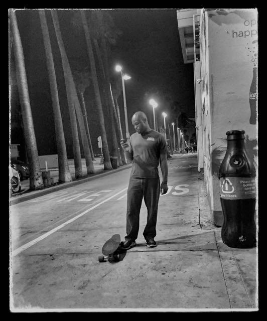 lone man boardwalk Venice