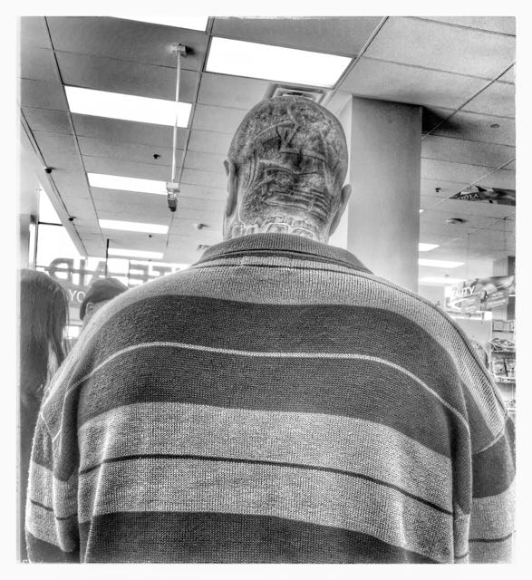 Tattooed head in line at Rite Aid