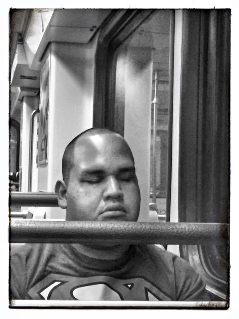 Superman asleep on the LA Metro