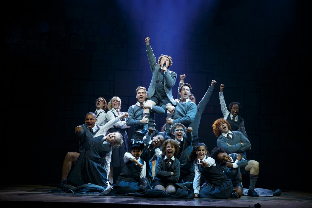 """Evan Gray (top center) and the Company of Matilda The Musical National Tour. Based on the beloved novel by best-selling author Roald Dahl, ""Matilda The Musical"" has a book by Dennis Kelly, music and lyrics by Tim Minchin and is directed by Matthew Warchus. ""Matilda The Musical"" will be presented May 29 – July 12, 2015, at the Center Theatre Group/Ahmanson Theatre. For tickets and information, please visit CenterTheatreGroup.org or call (213) 972-4400. Contact: CTGMedia@CenterTheatreGroup.org / (213) 972-7376 Photo by Joan Marcus """