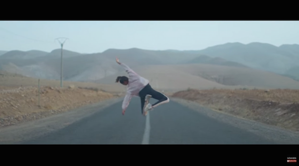 Hajiba Fahmi dances mid-air over a desert highway