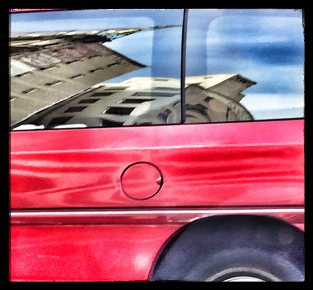 Reflections In A Van's Side Windows