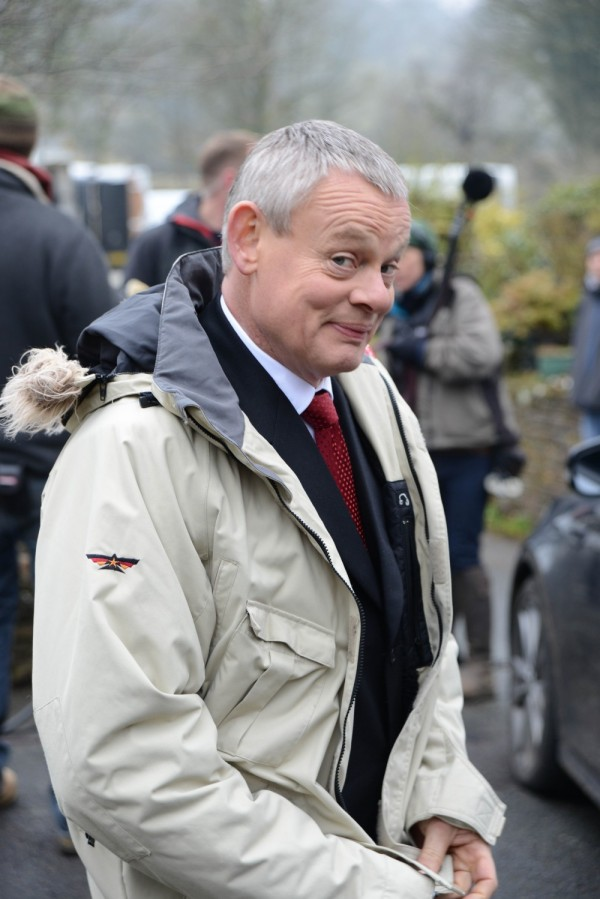 Martin Clunes takes a break in filming for DOC MARTIN, in which he plays the grumpy town surgeon who suffers from an odd distaste for the sight of blood!  From APT Syndication.