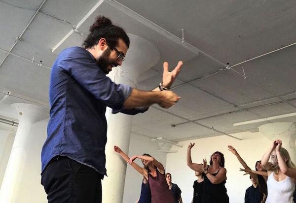 Leeav Sofer leads a gestural volunteer chorus