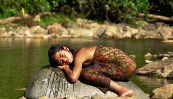 A girl from the Penan tribe, one of the many indigenous communities struggling to sustain their lives amid developmental projects and climate change. -Photo from http://www.survivalinternational.org/tribes/penan
