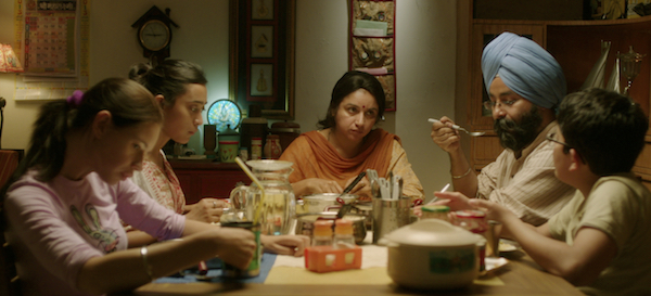 Family dinner scene in MARGARITA WITH A STRAW - Courtesy of Wolfe Video