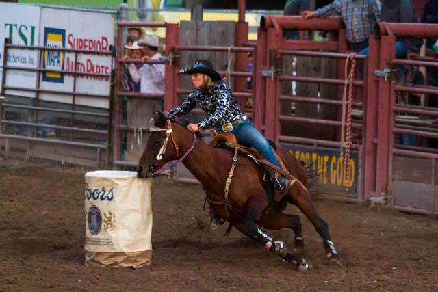 Athenian athletic gracious mythological cowgirl in the Helmville Barrel Racing Competition, 2015
