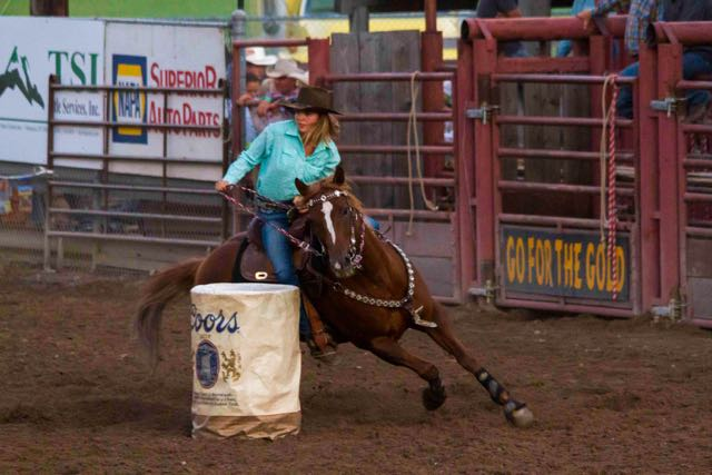 Just beautiful cowgirl demonstrating full on control in the Barrel Racing Competition, Helmville Rodeo, 2015