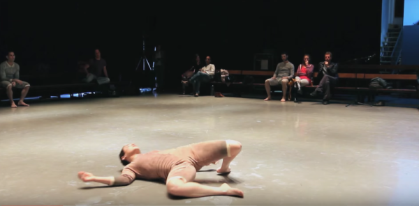 A dancer in rehearsal practices falling