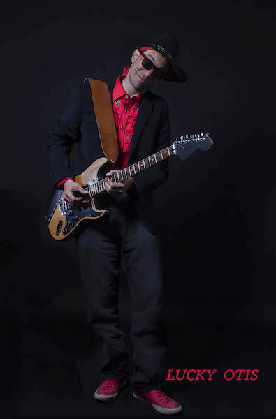 """""""The King of the Blues Players."""" Lucky Otis in the photography studio of Jim Storm in February 2017. Photography by Jim Storm."""
