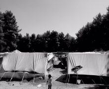 girl between tents