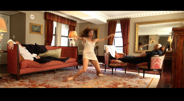 Maria Volpe dancing amongst sleeping men in ASJDFL;DJS;KJ