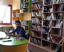 Abu Toha in his library