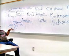 Musician Derek Menchan  teaching Humanities at Polk State College