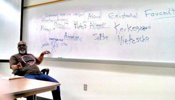 Musician Derek Menchan  teaching Humanities at Polk State College