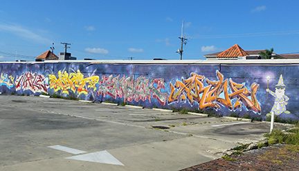 Graffiti and wizard mural stretches half a block.