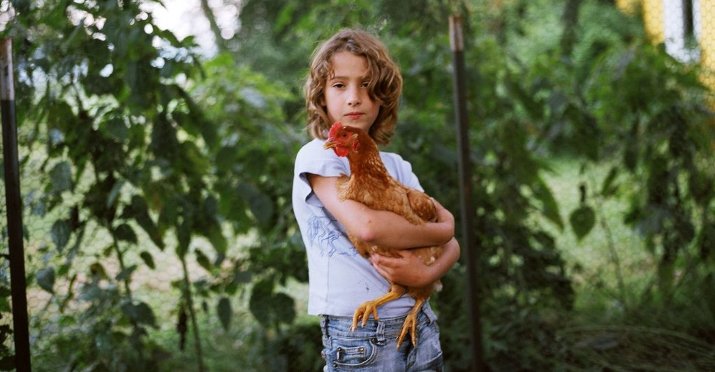 Olivia with Chicken © Anna Mia Davidson