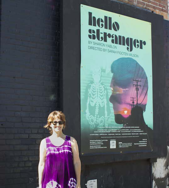 "Sharon Yablon, playwright, standing outside of the Theatre of N.O.T.E., where her theatrical production, ""Hello Stranger"" is now showing. Photography by Jim Storm. Cultural Weekly."