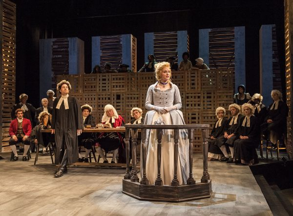Emily Goss, center, as Lucie Manette, pleading for her husband's release in A Tale of Two Cities.