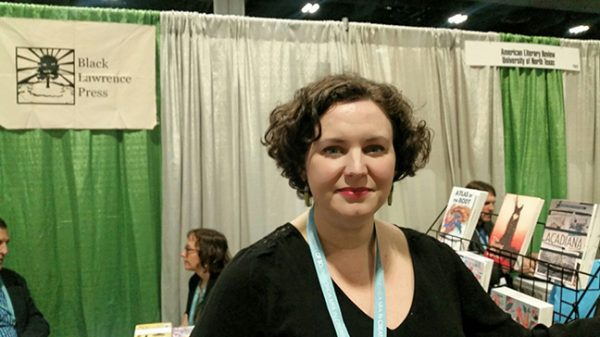 Editor Diane Goettel of Black Lawrence Press stands in front of the press's booth at the AWP book fair