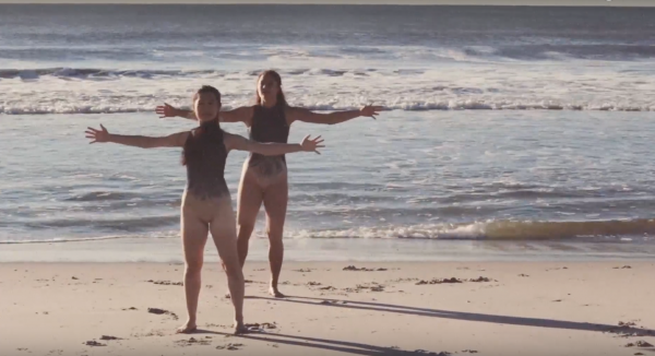 "Dancers with arms open wide in ""Love"""
