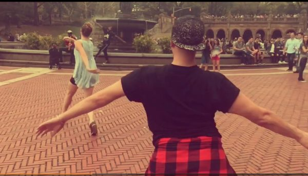 Two dancers pull the camera with them at Bethesda Fountain