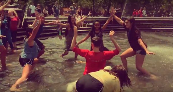 Nicole Walcott engages girls in fountain to dance with her