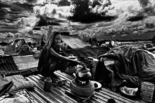 Woman cooking on a rooftop, by Shahidul Alam