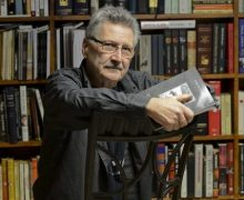 John Yamrus-landscape-books in background-for Interview