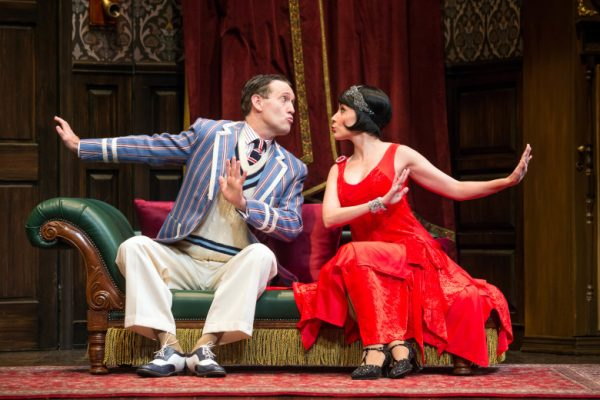 Ned Noyes & Jamie Ann Romero in The Play That Goes Wrong at The Ahmanson Theatre.