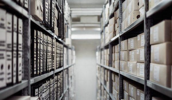 Files on racks. Photo by Samuel Zeller on Unsplash