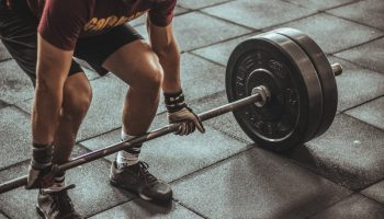 Lifting weights. Photo by Victor Freitas on Unsplash.