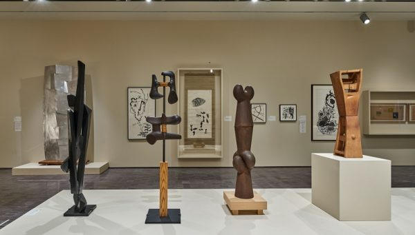 "Installation view of ""Changing and Unchanging Things: Noguchi and Hasegawa in Postwar Japan,"" with Noguchi sculptures in foreground, Hasegawa painting and drawings on the wall; 2019 photo (c) Asian Art Museum."