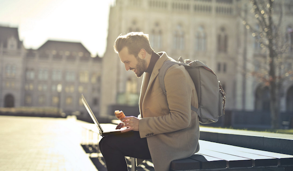Digital nomad on a bench. Photo by bruce mars via Pexels.