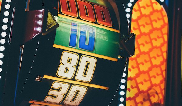 Slot machine. Photo by Krissia Cruz via Unsplash.