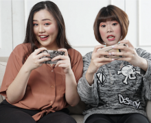 Two women playing social games. Photo by Afif Kusama via Unsplash.