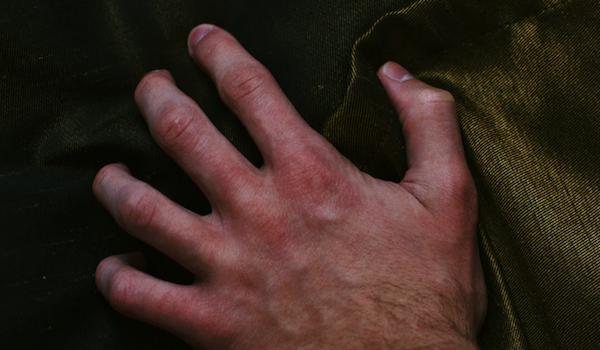 Left hand. Photo by Dmitry Bayer via Unsplash.