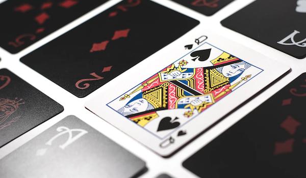 Playing cards; image by Esteban Lopez via Unsplash.
