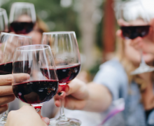 Wine celebration. Photo by Kelsey Knight via Unsplash.