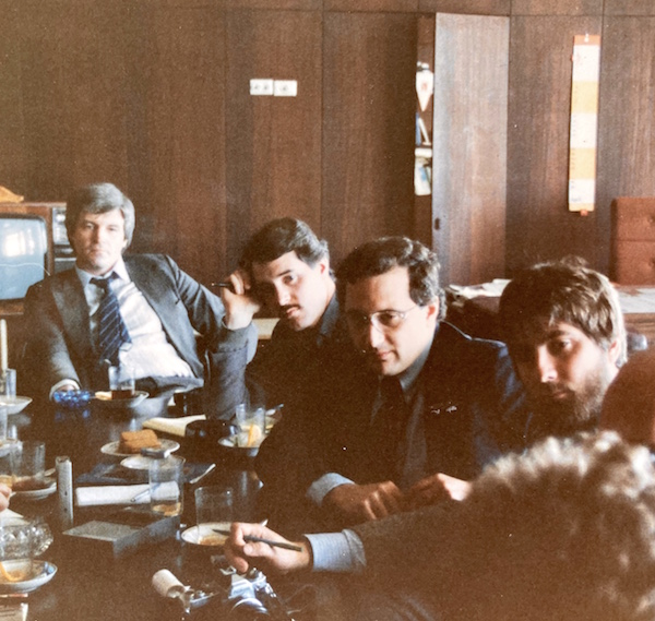 The author (with 'stash) meeting with a Pravda editor (at head of table) with other journalists in 1985. Photo: R. Daniel Foster