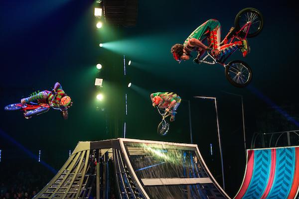 BMX riders perform spectacular stunts.