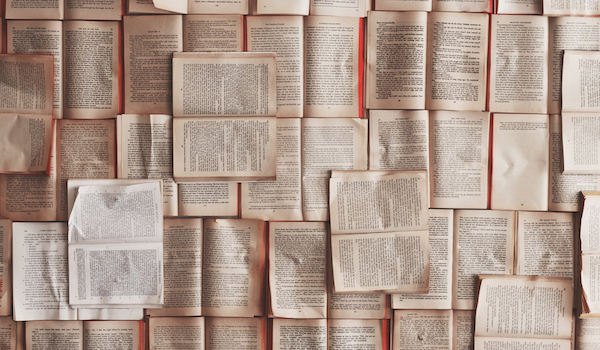Open pages. Photo by Patrick Tomasso via Unsplash.